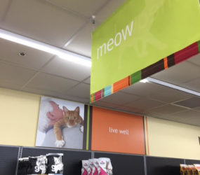 fabric sign hanging in a pet store