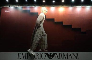 Armani billboard at night with three dimensional shoe